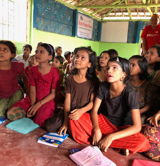 Rohingya youth listening with rapt attention as RSG volunteers teach basic English in a learning centre.  © RSG/Jonathan How