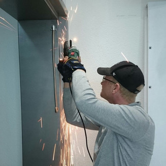 Fixing a door frame for a company, and installing new hinges