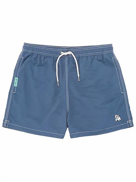 Bañador bermuda liso color azul indigo,dos bolsillos delanteros uno trasero