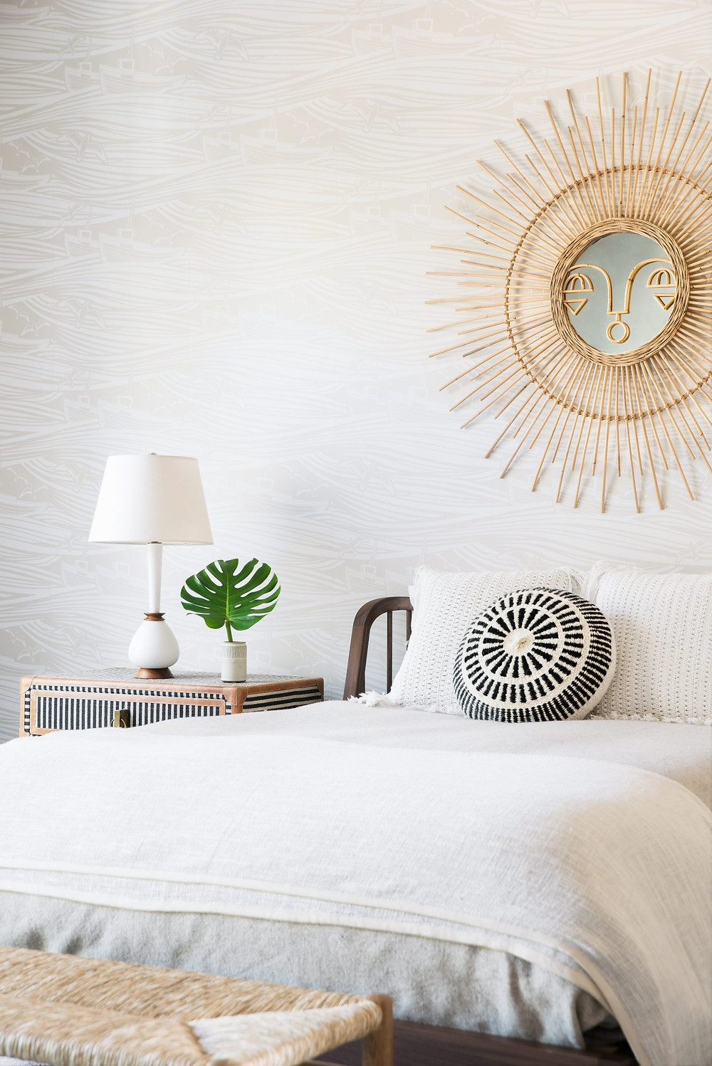 Charming bright and airy Modern Farmhouse Bedroom. Sun Mirror above Bed. Wave and Boat Wallpaper.