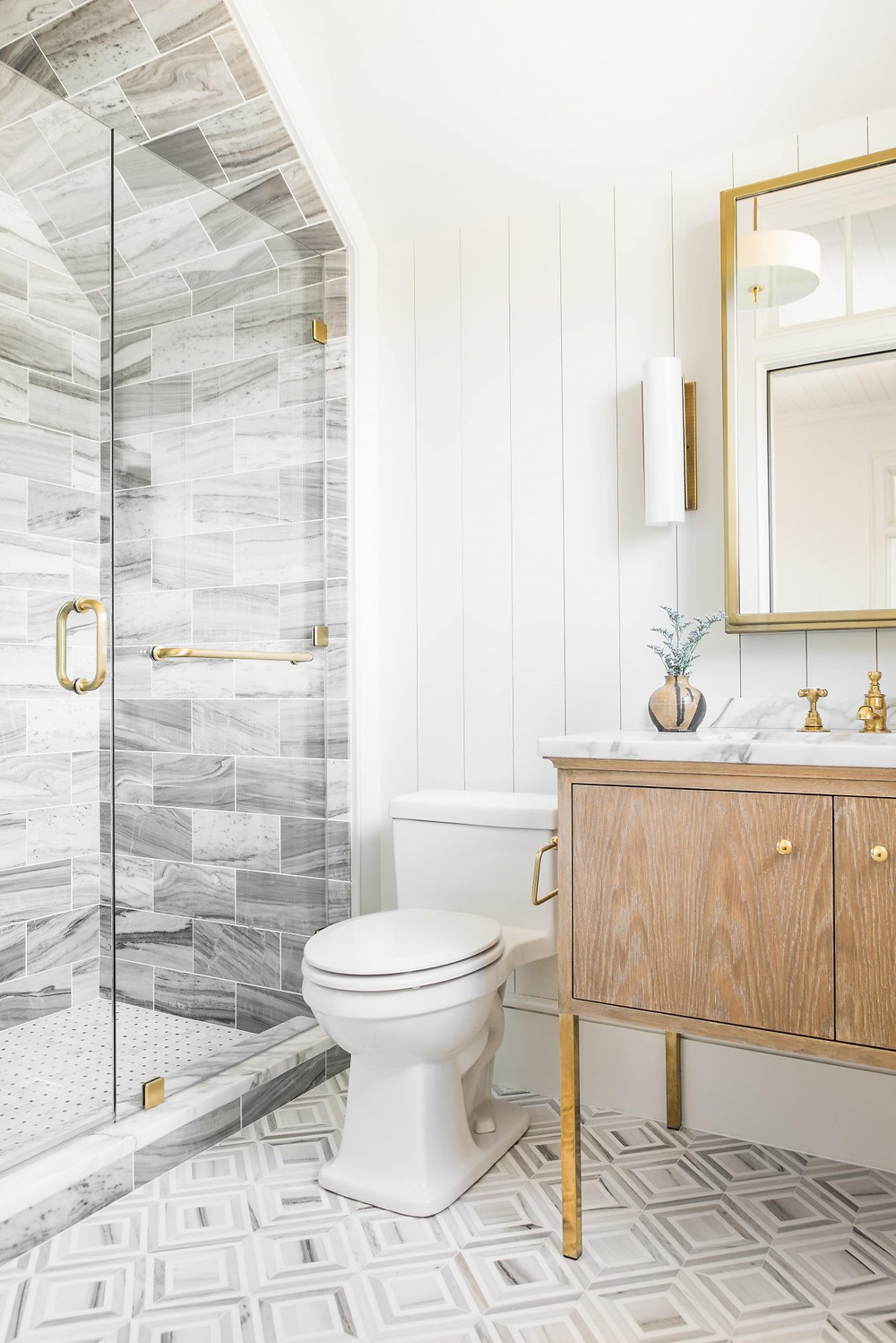 Charming bright and airy Modern Farmhouse Bathroom. Black and White Clawfoot Bathtub. Marble Shower. Brass Hardware. Timber and Marble Vanity. Brass Wall Sconces. Marble Tile Floors.