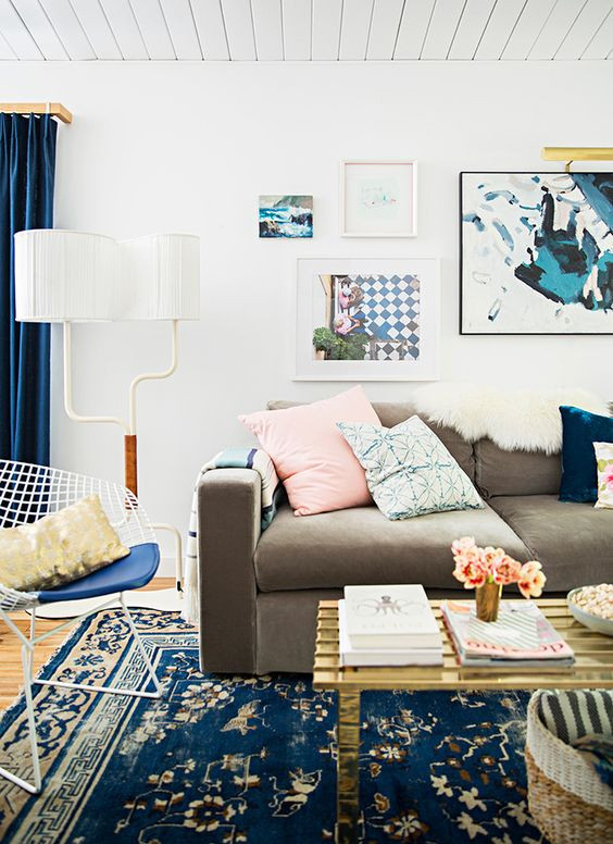 Colourful eclectic living room. Bohemian Rug and Art. Blues, dusty pink, and brass.