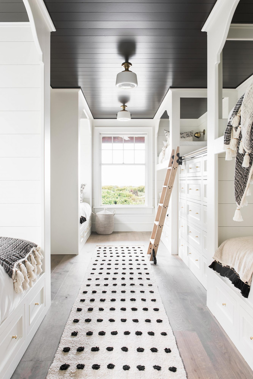 Modern Farmhouse Bunk Room. White Walls, Black Shiplap Ceilings. Beni Ourain Moroccan Runner. Timber Ladder. Natural Bunk Beds.