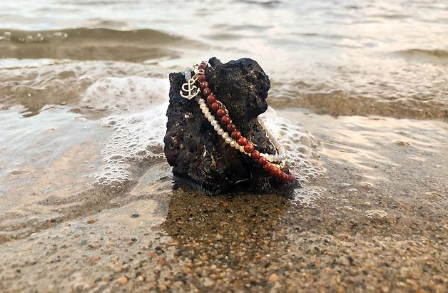 American Cancer Society Red Jasper Bracelet on rock in water