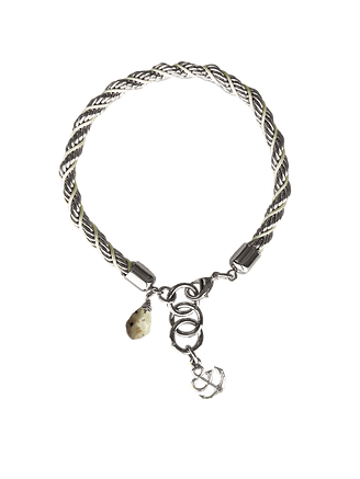 Twisted silver with cream rope with accent Dalmatian bead dangling alongside an anchor charm