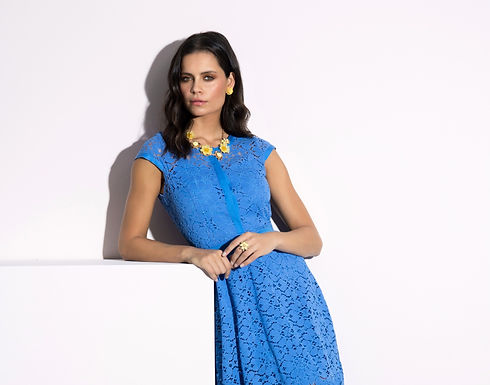 Model in sophisticated blue laced dressed with yellow flower accessories