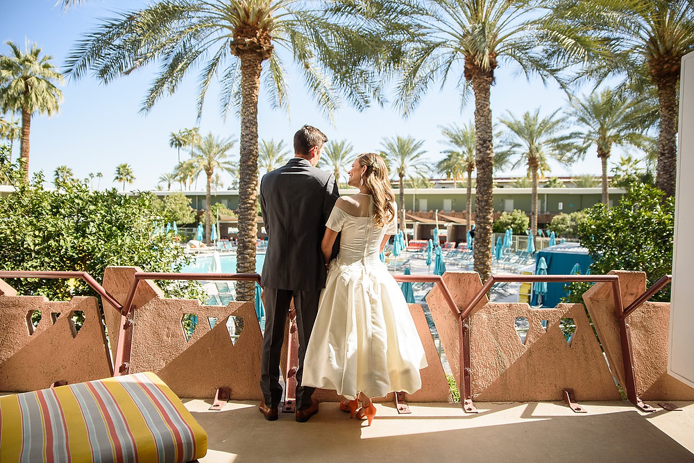 bride and groom standing together on the deck of their suite at hotel valley ho