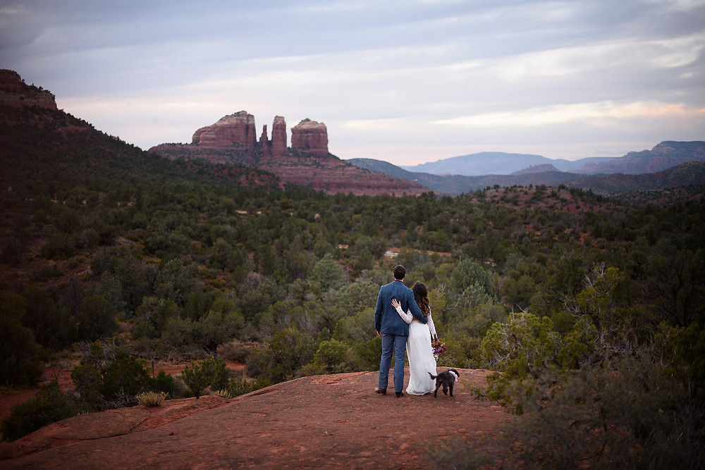 Newly married couple gazing out at Cathedral Rock