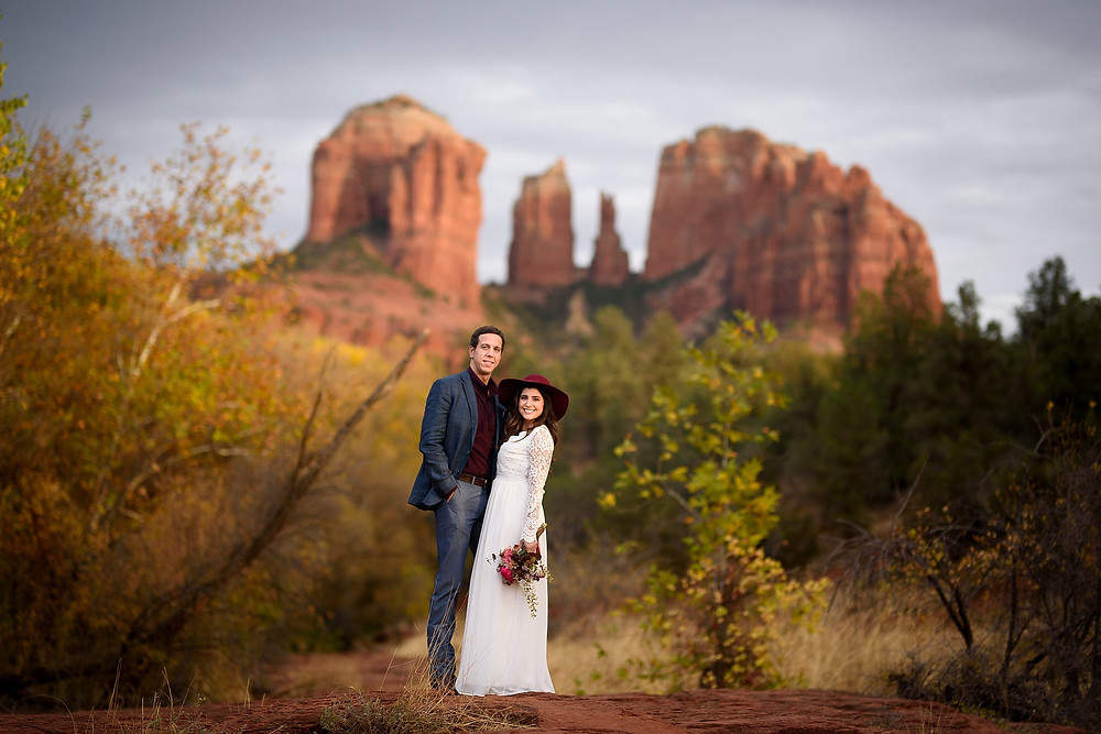 Couple standing near Cathedral Rock in Sedona for photos