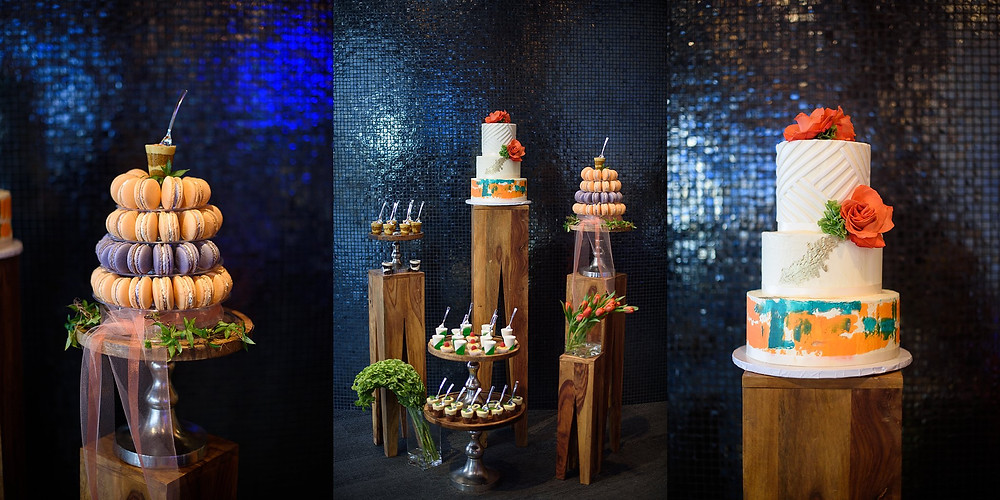 bright colored dessert display and wedding cake on tall wood stands