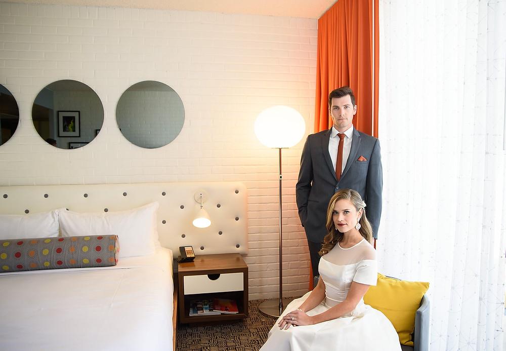 bride and groom sitting in hotel room in scottsdale az