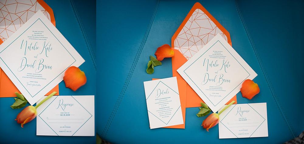orange wedding invitations on blue background