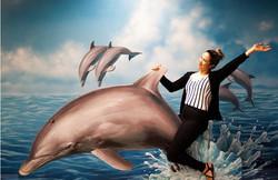 イルカに乗るポーズ