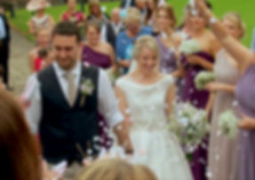 Still taken from wedding video of a newly married couple being showered in confetti