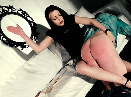 Denver Mistress Devi Spanking a slave over her knee