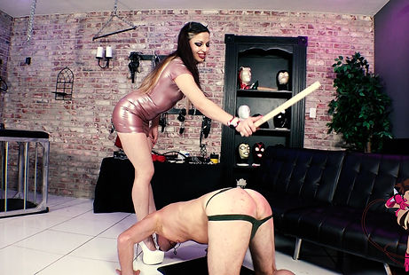 Denver Mistress Devi Paddling a bowing slave