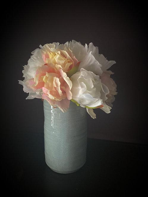 Short peony bouquet in blue ceramic vase