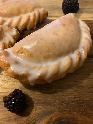 Blackberry Pie - Whole blackberries are lightly sweetened with sugar and a blend of vanilla and cinnamon.  This pie comes with a vanilla glaze.