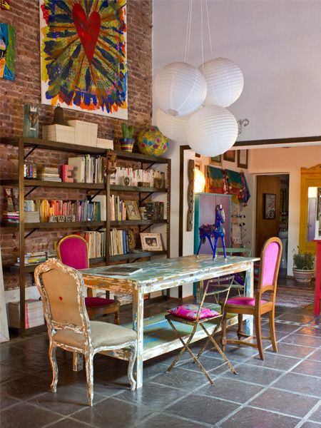 Decluttering for a maximalist pink dining chairs organised book shelf storage