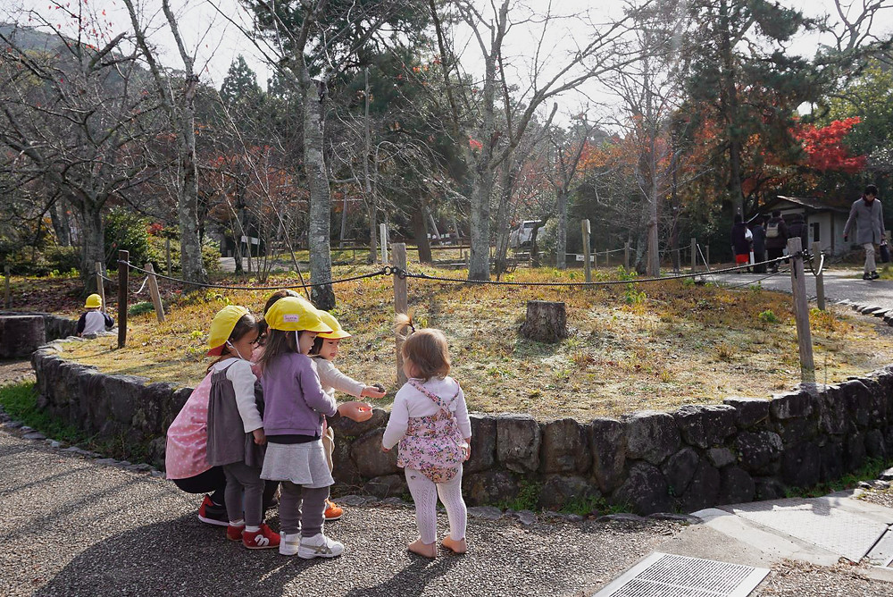 Cute Japanese kids making friends in Kyoto Park Japan