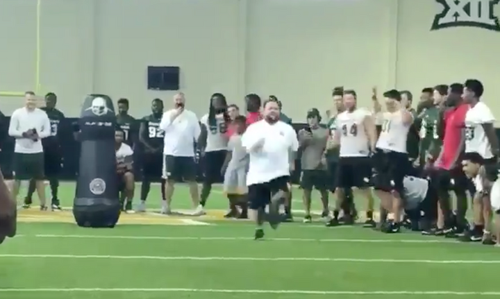 Baylor's Dir. of Football Ops Becomes Internet Star After Race With Tackling Dummy