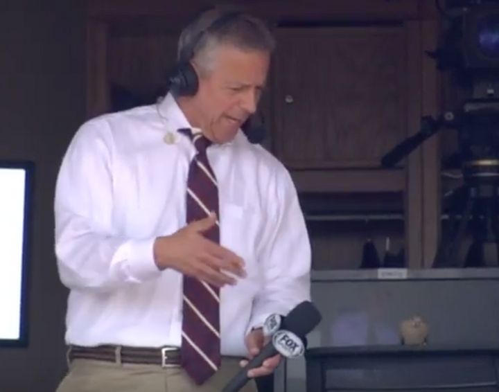 Thom Brenneman interviews real bird during Reds rally
