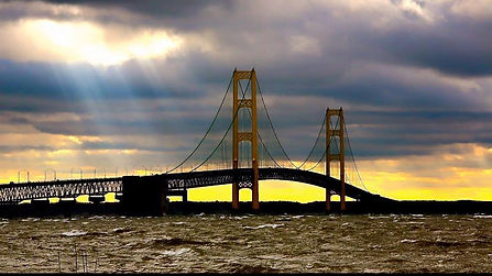 Sun shines through ominous clouds on Mighty Mac Swim course