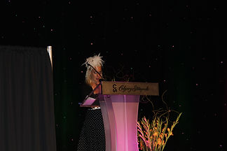 Ally speaking at the Calgary Stampede.