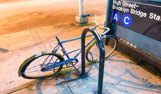 damaged electric bike abandoned at night