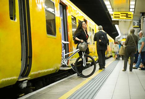 adult lady taking electric bike off train