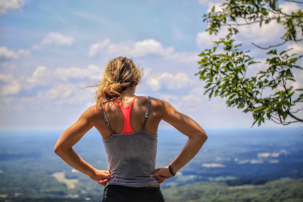 lady standing on hill in gym gear