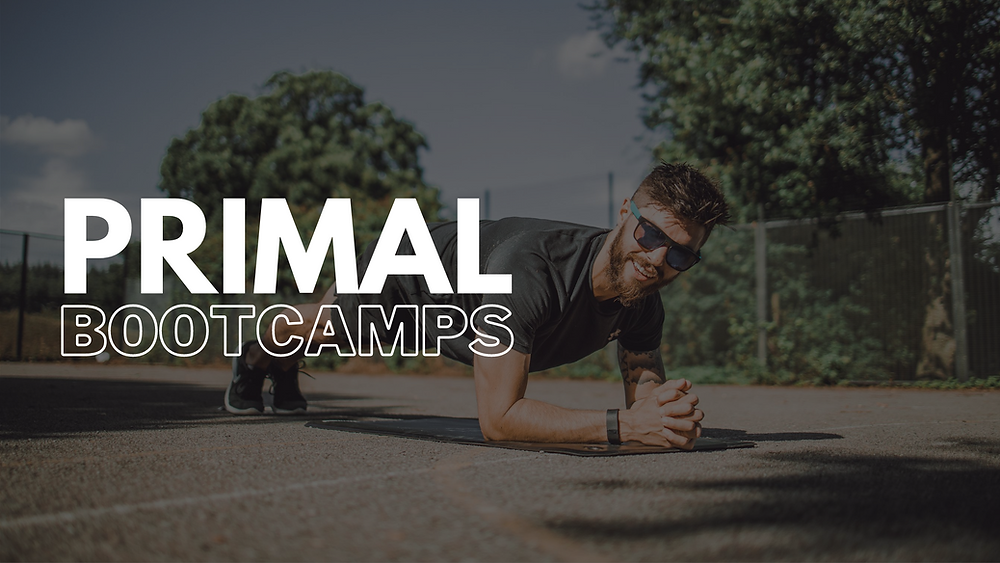 primal bootcamp - Ben Banbury in a tennis court doing a plank