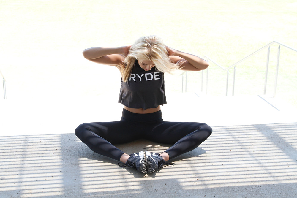 blonde lady wearing a ryde tank top