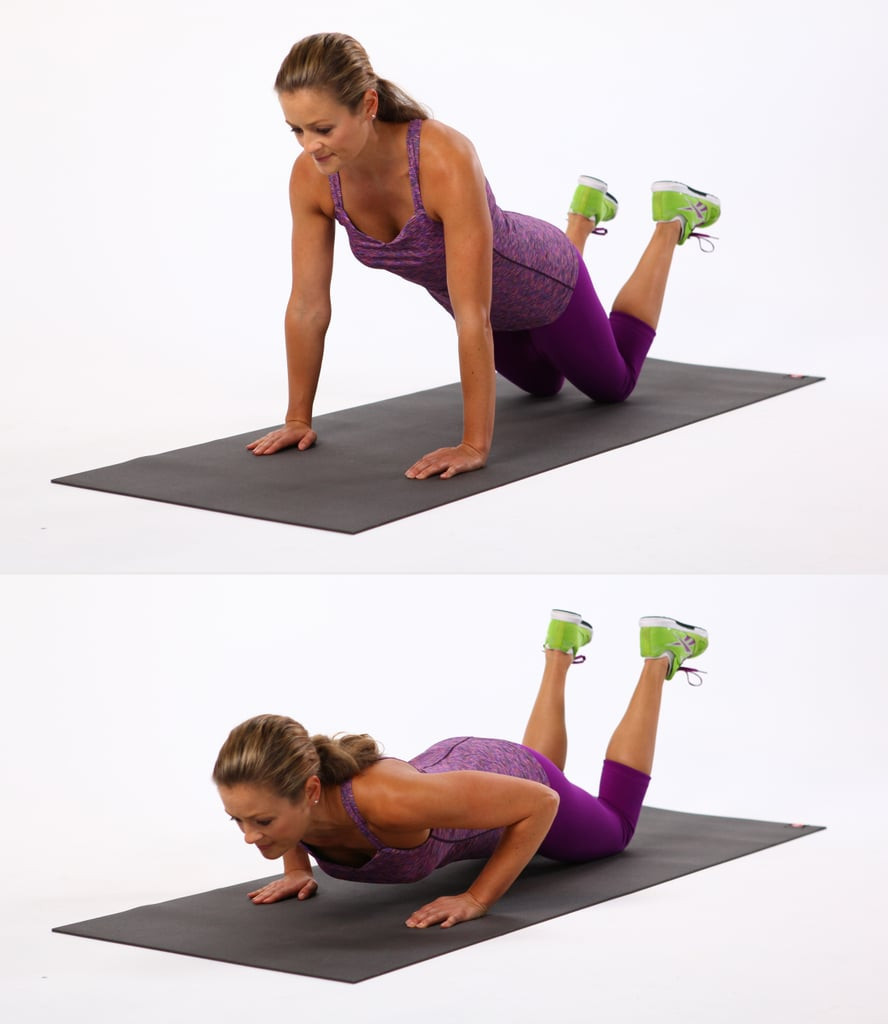 Fitness lady doing pressups on an exercise mat