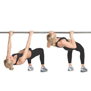 Fitness lady doing inverted rows