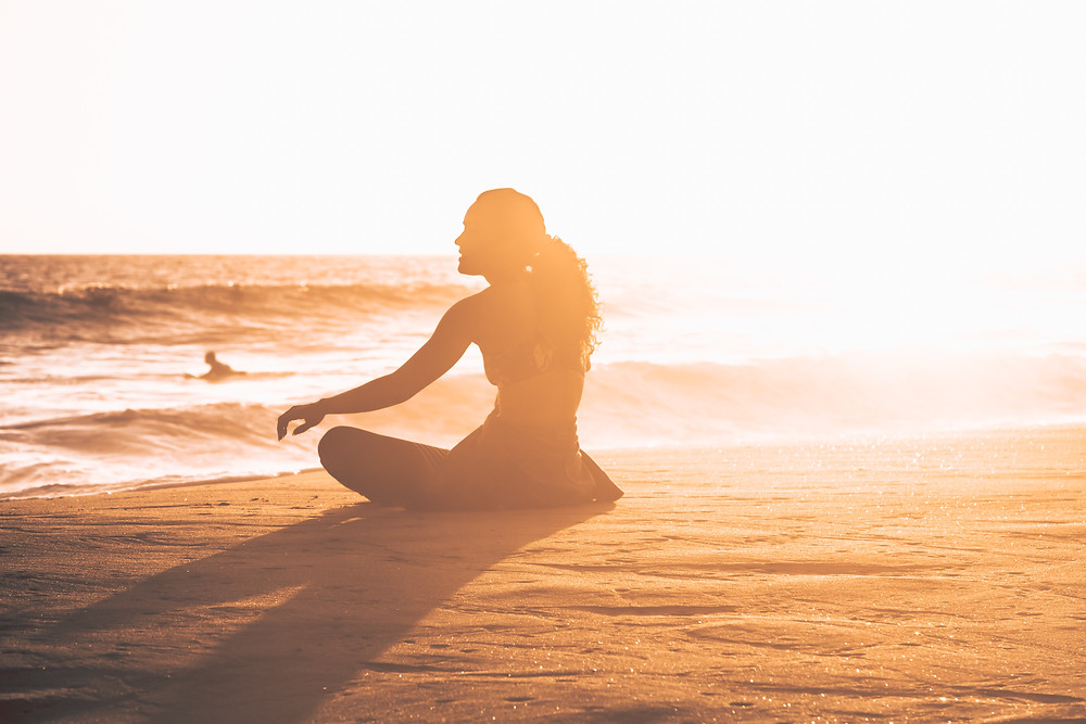 fitness woman on a beach at sunset