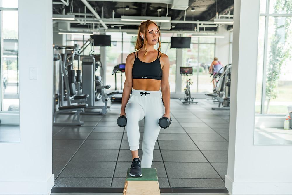 woman in white leggings in gym