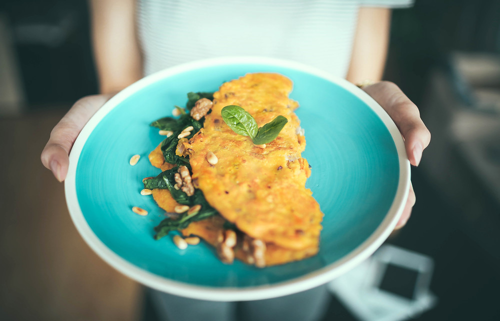 a blue plate with an omelette