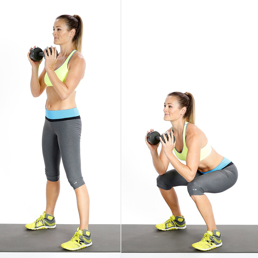 Lady squatting with kettlebell