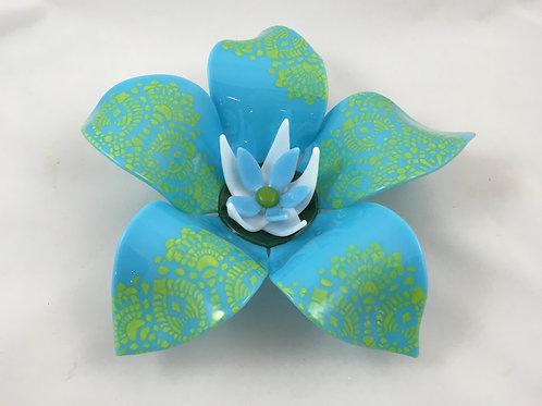 Cyan blue glass flower with yellow screen printed enamel