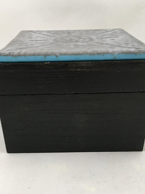 "Black hinged wooden box with ""batiked"" glass top"