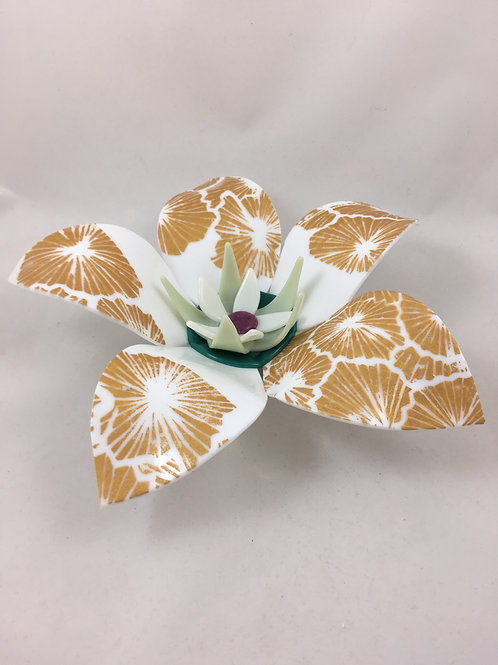 White glass flower with gold enamel