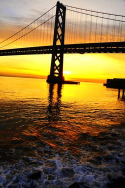 Bay Bridge sunrise with the water