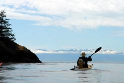 Kayaking towards the Cascade Mountains