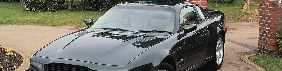 Shiny Black Car in Driveway