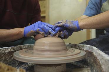 2 hands on pottery wheel landscape.jpg