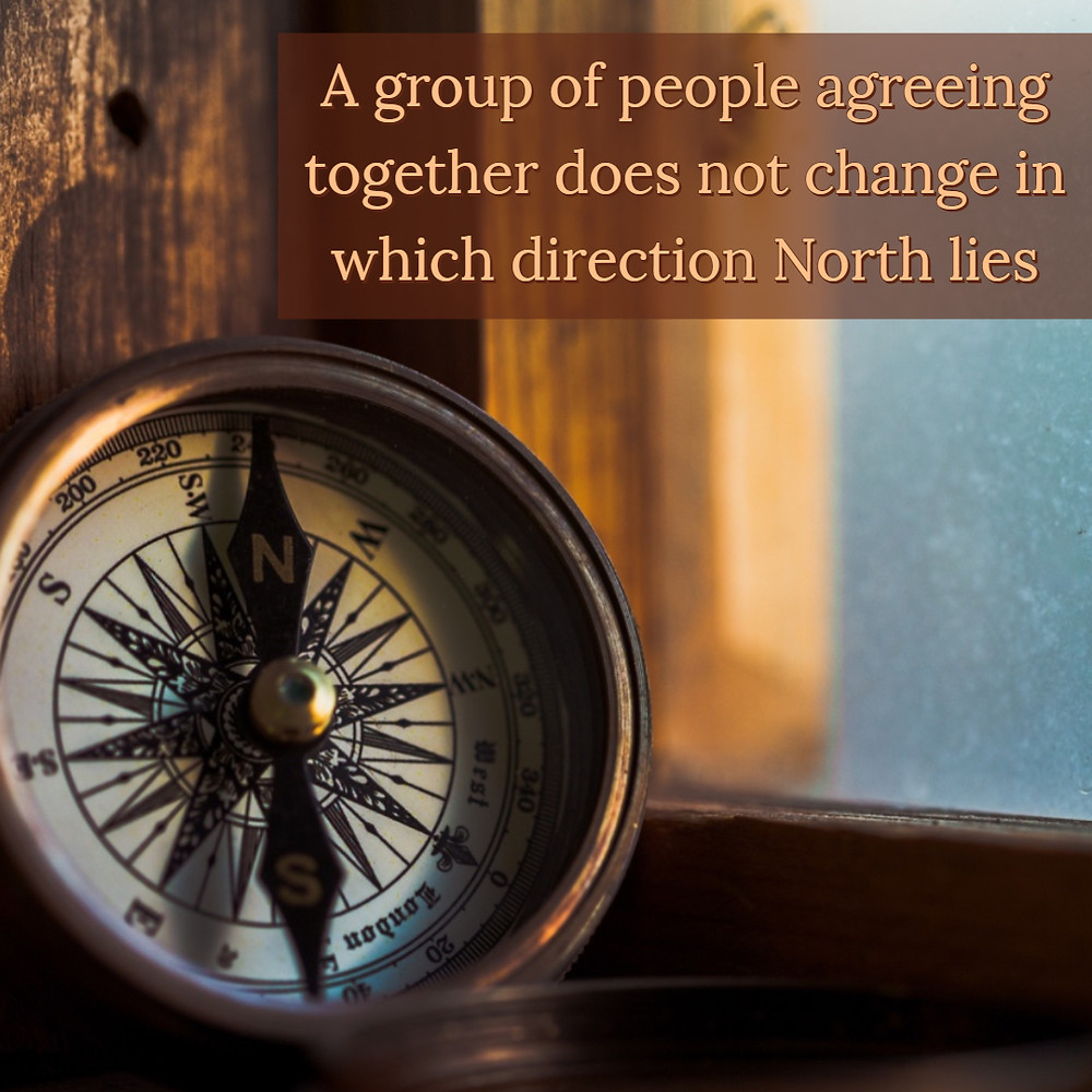 A group of people agreeing together does not change in which direction North lies