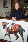 Artist Ruth Buchanan with framed painting of a dressage horse