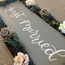 On of Black Gold Limousine's Just Married Signs