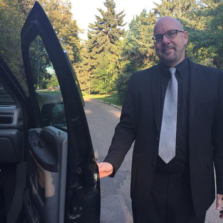 Driver of Edmonton Limo Service Black Gold Limousine
